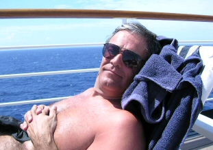 husband enjoying the sun on a cruise ship