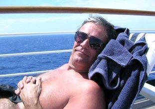 husband enjoying the sun on a cruise ship
